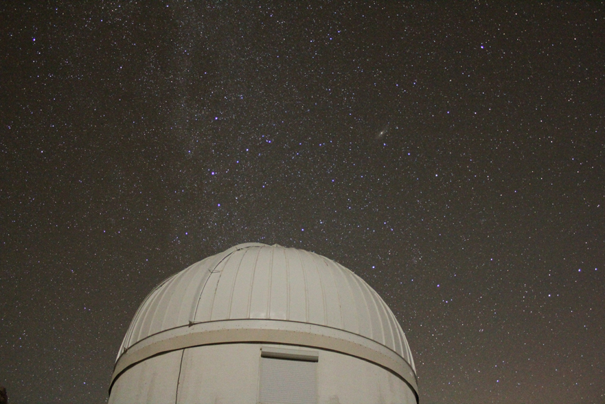 Cassiopeia rising over a dome at Kitt Peak