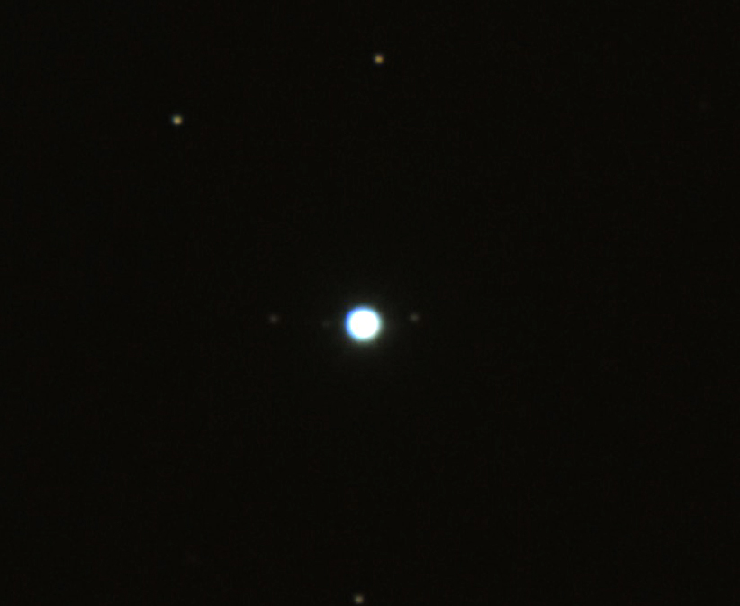 Uranus and moons. From left to right, Oberon, Umbriel and Titania.